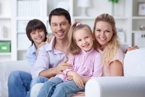 Happy Family With Insurance Coverage